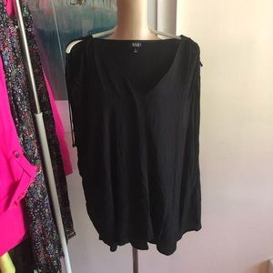 Black blouse with adjustable sleeve options.